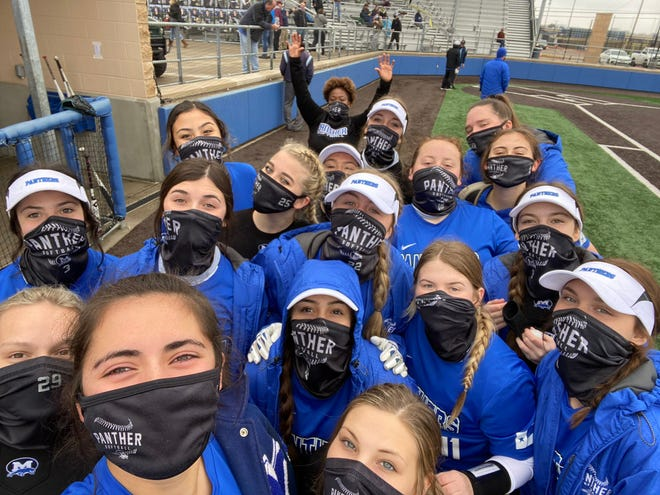 Midlothian High School softball players pose for their first victory selfie of the 2021 season.
