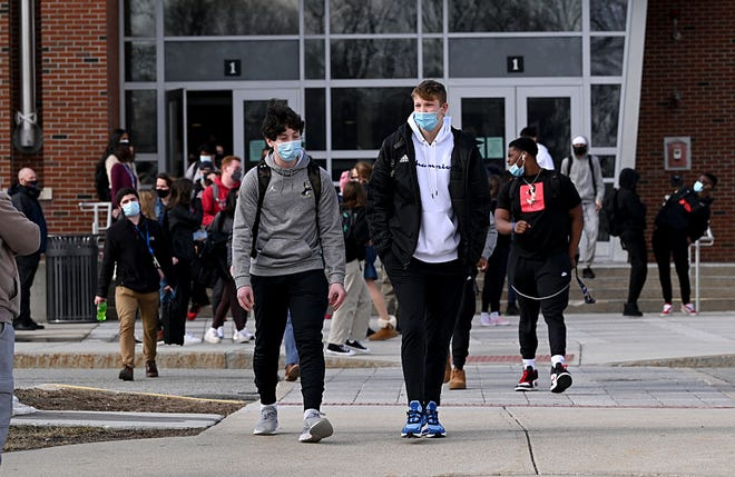 Students leave Framingham High School at the end of the school day, March 3, 2021.