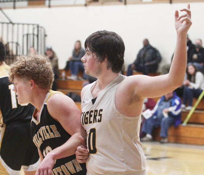 Higbee junior Jamie Smith (#40) raises his left arm looking to receive the basketball near the right block during a home basketball game played earlier this season. Smith contributed three points Tuesday to help the Tigers defeat Northwest-Hughesville 62-50 in Class 1 state sectional action.