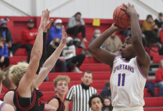 Moberly High School sophomore Derieus Wallace (#11) scored 12 points Tuesday during the Spartan boys season ending 65-49 loss to Kirksville in a Class 5 District 15 semifinal game.