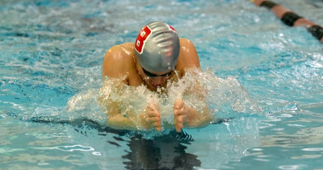 Thomas Zoldowski of Bedford swims the breaststroke in the 200 yard medley relay Tuesday evening against Monroe. Zoldowski won two individual events and swam on two winning relays as the Mules won 133-41.