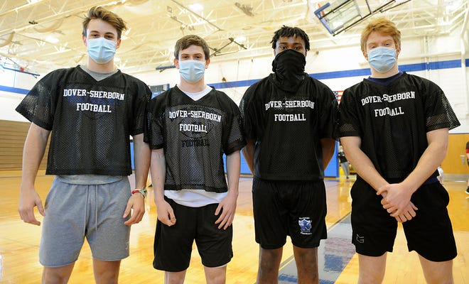 Dover-Sherborn Regional High School football captains from left: Grady Russo, Johnny Bennett, Timothy Cofield, and Oliver Ferrari at practice, March 2, 2021.