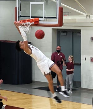 Oak Ridge's Stafford Shanklin goes up for a dunk in the Tuesday, March Region 2-AAA semifinal matchup against Maryville in Oak Ridge.
