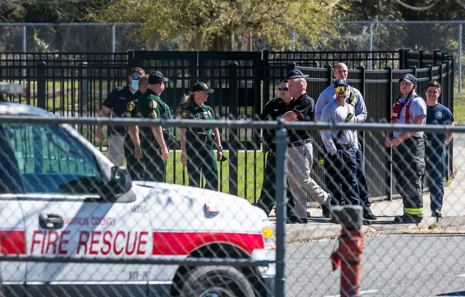Marion County Sheriff's deputies and Marion County Fire Rescue officials congregate outside the entrance to Lake Weir High School on Wednesday. Four students and a teacher were taken to local hospitals after being exposed to fumes from what Marion County Fire Rescue thought was a faulty HVAC system. Two other students were released to their parents. MCFR's hazmat team set up monitors and found no problems or hazards.