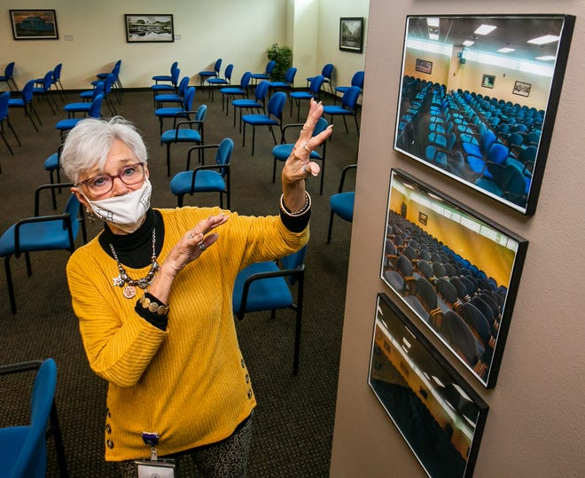 Ruby Moore, supervisor of court services, shows a picture of how close the chairs in the jury assembly room were spaced before the pandemic. Now the chairs, shown behind her, are placed 6 feet apart to ensure social distancing. Hundreds of people are scheduled to arrive at the courthouse on Monday and Tuesday for jury service.