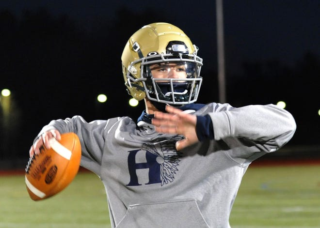 Hanover quarterback Michael Landolfi sets to pass during football practice on Monday, March 1, 2021.