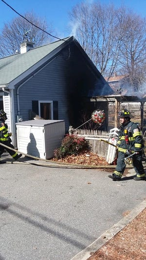 Randolph firefighters extinguished a fire in a detached garage at a Jane Street home Tuesday.