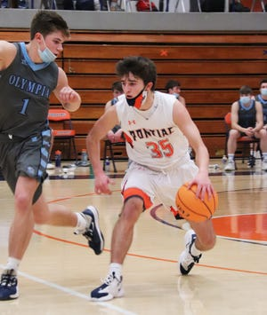Pontiac freshman Michael Kuska pulls up against Olympia defender Ethan Davis last Friday. Kuska had 12 points in leading Pontiac in scoring in a 70-46 loss at Monticello on Tuesday. Davis was the leading scorer for Olympia in its loss to Prairie Central Tuesday.