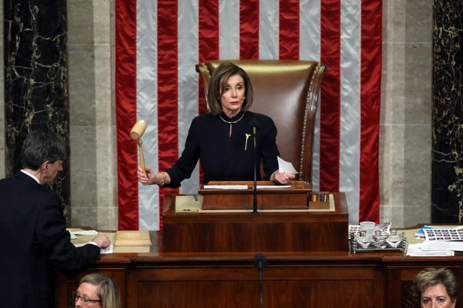 Speaker of the House Nancy Pelosi, D-Calif., presides over Resolution 755 as the House of Representatives votes on the second article of impeachment of U.S. President Donald Trump in the House Chamber at the U.S. Capitol Building on Dec. 18, 2019 in Washington, D.C. The House voted Friday to approve a $1.9 trillion COVID-19 relief package. The bill now goes to the Senate. (Chip Somodevilla/Getty Images/TNS)