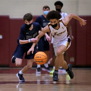 Moses Brown's Peter Buonanno races Times2's Kobe Pena for a loose ball in the first half of Thursday quarterfinal game.