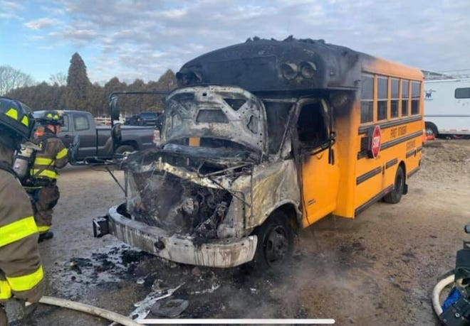 Tiverton firefighters put out a fire in a school bus Wednesday morning. Nobody was injured.