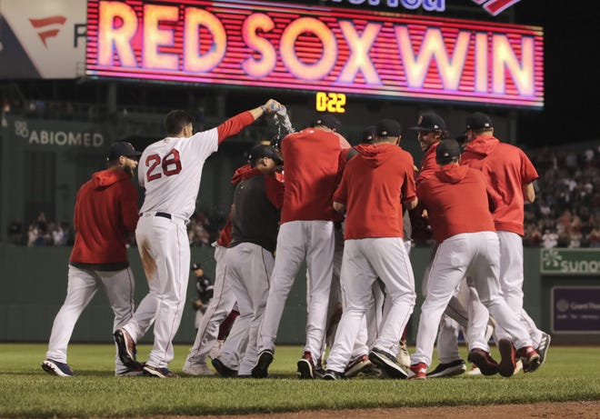The Red Sox celebrate a walk-off win against the White Sox in 2019.