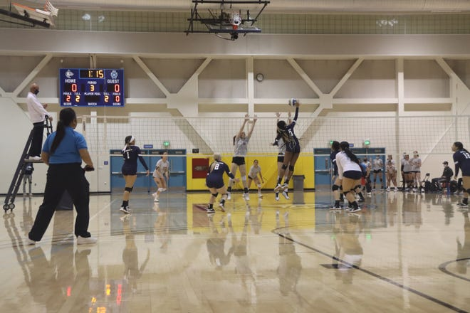 Cerro Coso's middle, Tyara Smith, goes up against a solo block during Friday night's scrimmage against Antelope Valley.
