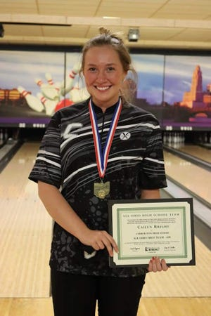 Carrollton senior bowler Cailyn Bright poses with her medal after winning the Division II individual state championship