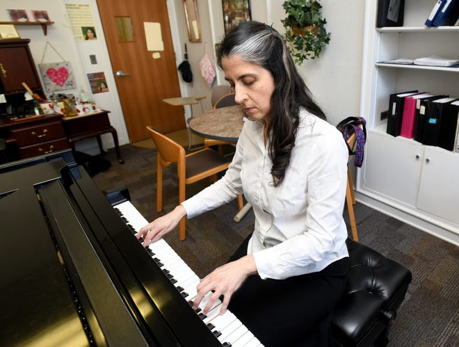 Maira Liliestedt, a music professor at Mount Union and resident pianist for the Alliance Symphony Orchestra, practices in her campus office. Wednesday, March, 3, 2021.