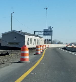 Interstate 77 has a new resident? A tractor-trailer hauling a mobile home had to leave the building along the highway Tuesday when it wouldn't pass through a constricted construction zone near the interchange with U.S. Route 30. Lori Steineck / The Canton Repository