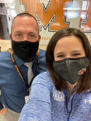 Julie Trop, local store marketer at Texas Roadhouse in Alliance, and Garry Tausch, principal of Washington Elementary School.