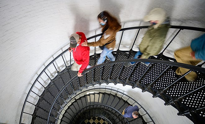 Visitors to the St. Augustine Lighthouse and Maritime Museum walk down the 219 steps from the observation deck of the lighthouse on Wednesday, March 3, 2021. The museum is requesting $484,628 in funding from the state to paint and repair part of the staircase.