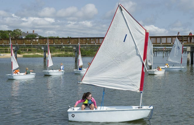 Children in the St. Augustine Yacht Club's Junior Sailing Program maneuver their boats in Salt Run, near the St. Augustine Lighthouse in 2016.