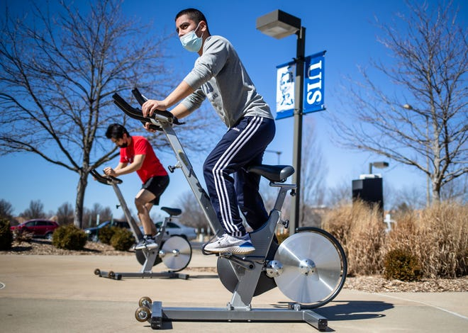 University of Illinois Springfield sophomore Sebastian Haro participates in his first spin class during UIS Campus Rec's outdoor spin class led by Amber Pye, UIS Campus Rec assistant director, on the concourse outside the Recreation & Athletic Center on the UIS campus in Springfield, Ill., Wednesday, March 3, 2021.