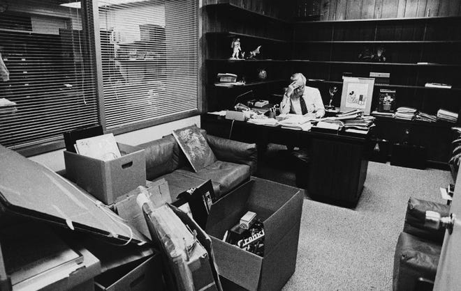 """Walter Cronkite works on script at the desk of his office in the CBS-TV broadcast center in New York as partly packed boxes sit in foreground. The veteran newscaster was preparing for his final telecast as anchorman of CBS-TV's """"Evening News"""" on March 6, 1981."""