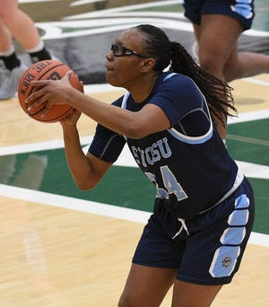 Former Shawnee standout and current Southwestern Oklahoma State Bulldogs Makrya Tramble sets up for a shot during the 2020-2021 season.