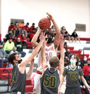 Heston Wiggs of Constantine puts up a jumper around Coloma defenders on Tuesday.