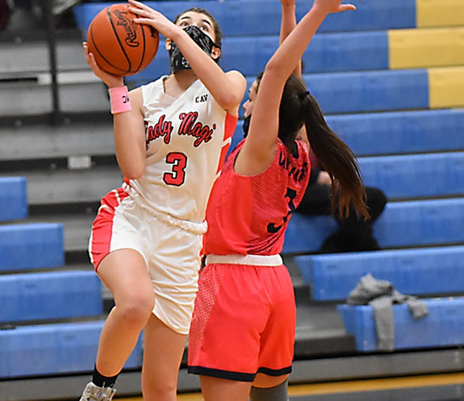 Lexus Gentz looks to avoid contact while hoisting up a shot against Climax-Scotts on Tuesday.