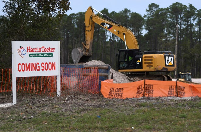 Construction crews prep for the new Harris Teeter at the corner of Carolina Beach Road and Independence Boulevard in Wilmington, N.C., Wednesday, March 3, 2021. It will be the grocery store chains largest store in the region.   [MATT BORN/STARNEWS]