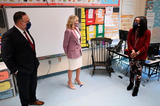 First lady Jill Biden and Education Secretary Miguel Cardona visit a classroom as they tour Benjamin Franklin Elementary School, Wednesday, March 3, 2021 in Meriden, Ct. (Mandel Ngan/Pool via AP)