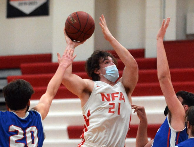 NFA's Joe Klick shoots between Waterford's Trevor D'Amico, left, and Sean O'Connell Tuesday during NFA's 57-50 win in Norwich.