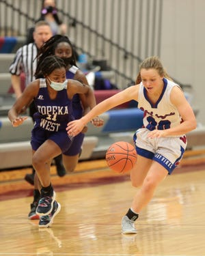 Seaman senior Raigan Kramer steals the ball from Topeka West sophomore Emma Noble in the second half of Tuesday's Class 5A sub-state tournament at Seaman. The Vikings won 60-33.