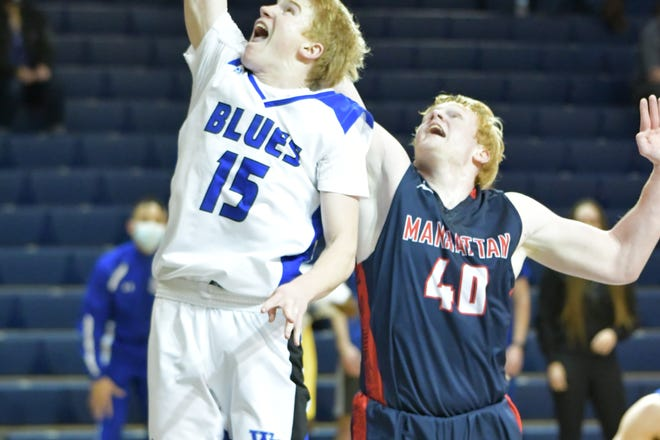 Washburn Rural's Jack Hutchinson (15) did his damage at the rim against Manhattan's Cade Wilson or beyond the arc, hitting three 3-pointers on his way to a 17-point game in the Junior Blues' 51-33 Class 6A sub-state win Tuesday at Rural.