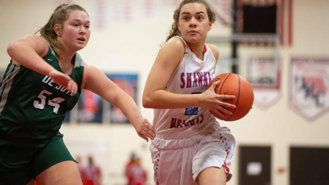 Shawnee Heights senior Adysen Burghart, right, scored a team-high 10 points in Tuesday night's Class 5A sub-state matchup at DeSoto, but the T-Birds shot just 25.5% from the field in the season-ending 45-34 defeat to the Wildcats.