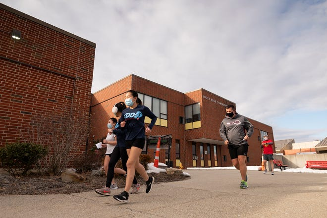 Cross-country athletes take off for a short run from South High during Wednesday's workout.