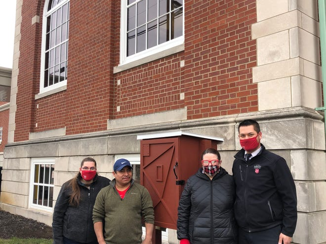 The Tuscarawas County Public Library System recently installed a Little Free Pantry adjacent to the County Library's Main building, 121 Fair Ave NW, New Philadelphia. Pictured, from left: Salvation Army social worker Shelly Gomez, Jose Gomez, and Salvation Army Lieutenants Amanda and Andrew Allen.