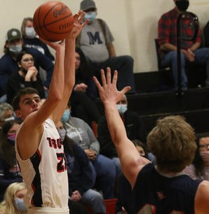 Tusky Valley's Logan Stotzer shoots a 3-pointer over Morgan defender Colin Janes in the Division III District semifinal game Tuesday.