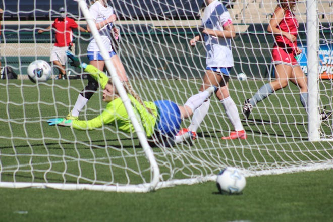 A late goal by Cardinal Gibbons' Sydney Polivka gets past Arnold goalkeeper Allie Dalton to make it 2-0 in Wednesday's Class 4A state championship game at Spec Martin Stadium in DeLand.