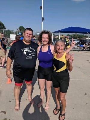 Eric Medina, his wife Becky Medina (center) and Marijane Martinez (right) at the Tinman Triathlon in Lamar in July 2019.