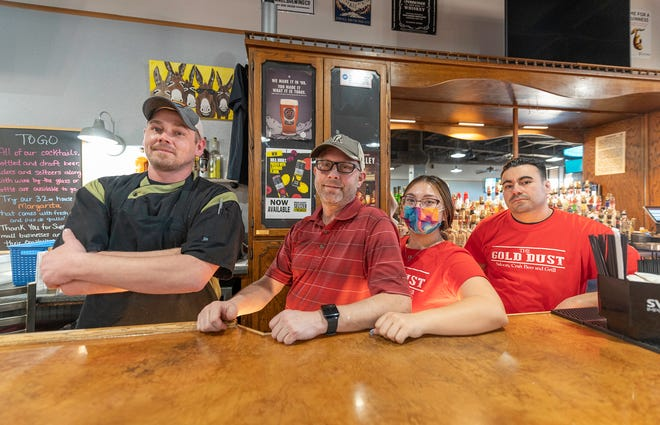 From left, chef Oz Osbourne, owner Michael Mahan, Autriana Martinez, and Tony Martinez of The Gold Dust Saloon, Craft Beer and Grill.