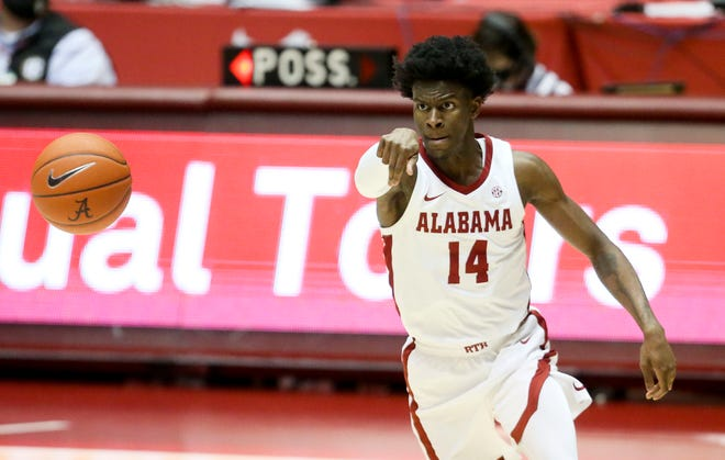 Alabama guard Keon Ellis (14) makes a pass against Auburn Tuesday, March 2, 2021, in Coleman Coliseum. [Staff Photo/Gary Cosby Jr.]