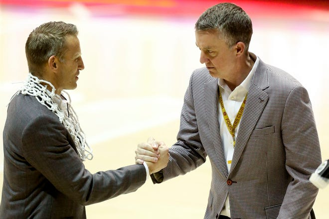 Alabama Athletics Director Greg Byrne congratulates Alabama Head Coach Nate Oats after Alabama defeated Auburn and celebrated the Tide's regular season SEC Championship Tuesday, March 2, 2021, in Coleman Coliseum. [Staff Photo/Gary Cosby Jr.]