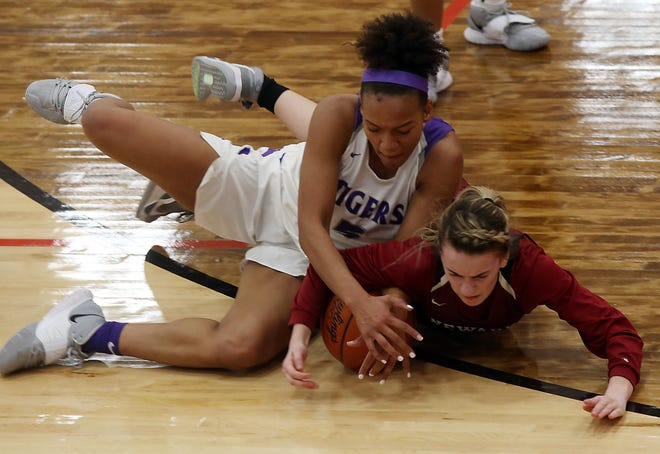Central's Jocelyn Tate and Newark's Peyton Lunsford fight for the ball during the Tigers' regional semifinal loss March 2. Defense was the calling card for the Tigers, who won their sixth consecutiveDivisionI district championship.
