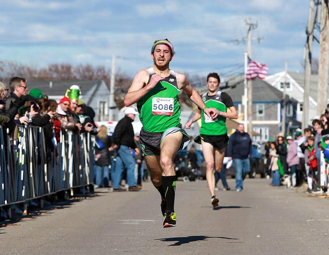 Joe Prizzi sprints to a second place finish in the 2019 MEF St. Patrick's Day 5K.