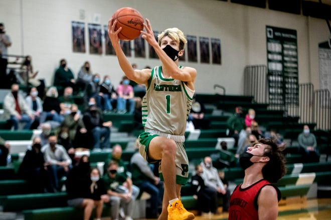 Pennfield junior Luke Davis (1) shoots the ball on Tuesday, March 2, 2021 at Pennfield High School in Battle Creek, Mich. Pennfield defeated Jackson Northwest 68-34.