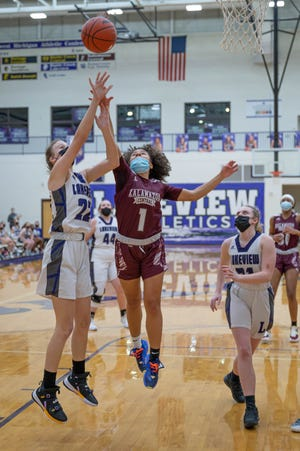 Lakeview's Madalyn Belmore (22) goes for the hoop as Kalamazoo Central's Alaila (1) puts on defensive pressure during first half action on 3/2/21.