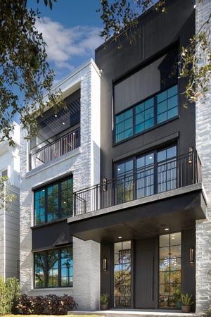The New American Home, with 4,397 square feet of living space, features an inverted layout, so the main living areas are located on the third floor for space optimization and a treehouse feel despite its urban location.