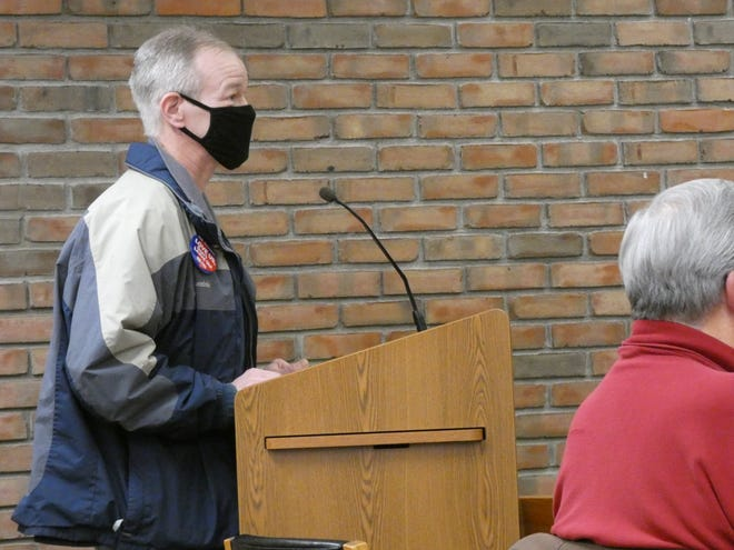 Steve Pifer, vice president of IUE-CWA Local 704, speaks to members of Bucyrus City Council on Tuesday evening, asking city leaders to join him in a trip to Bentonville, Arkansas. Union leaders hope to convince Walmart officials to intervene in GE-Savant's plan to stop making A-19 LED bulbs at the Bucyrus plant.