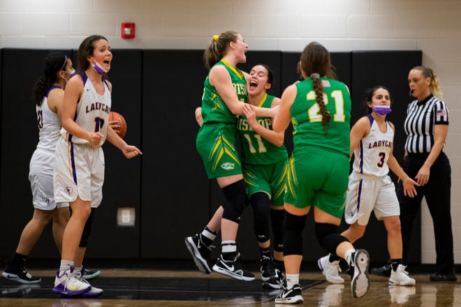 Bishop's Madalyn Ruiz celebrates  with her teammates after tying the game at the end of the four quarter in the Class 3A regional semifinal against Skidmore-Tynan at H.M. King High School in Kingsville,Texas on Tuesday, March 2, 2021.