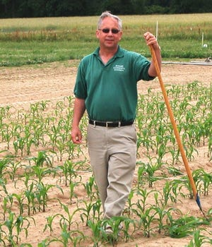 Burlington County  agricultural agent Ray Samulis hand cultivates a field trial for sweet corn at the county agricultural center in Moorestown before retiring retiring in 2017 after 41 years as the county agent employed by the Rutgers Agricultural Extension Service office. He passed away Feb. 24.